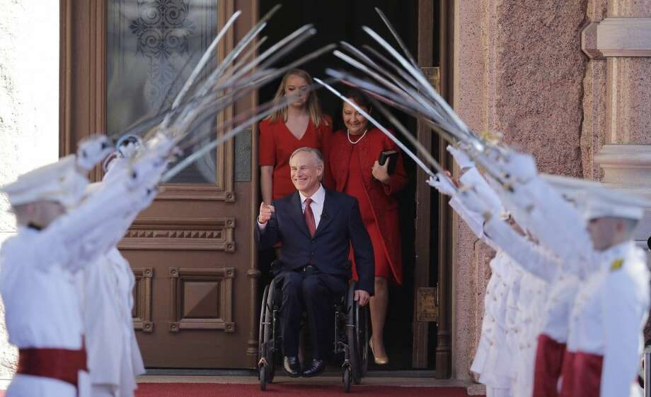 Texas Gov.-elect Greg Abbott arrives for his inauguration with his wife, Cecilia, right, and daughter, Audrey, on Tuesday in Austin. Photo: Eric Gay