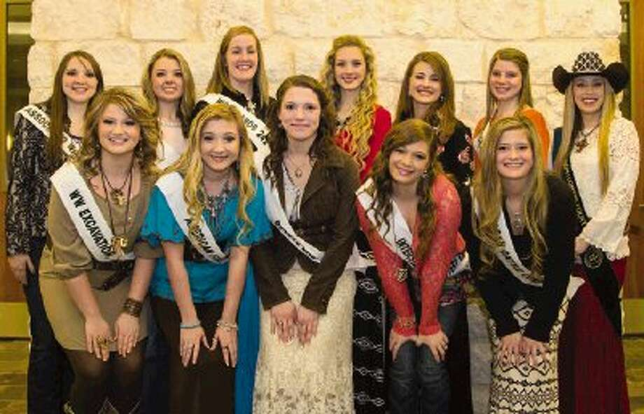 The 2014 Montgomery County Fair Queen candidates and last year's winner, Emily Strozier, pose for a picture at the Lone Star Convention & Expo Center Monday night in Conroe. Young women from Caney Creek High, Willis High, Conroe High, The Woodlands College Park High, Montgomery High and Oak Ridge High will be competing for scholarships. Photo: Staff Photo By Ana Ramirez / The Conroe Courier/ The Woodland