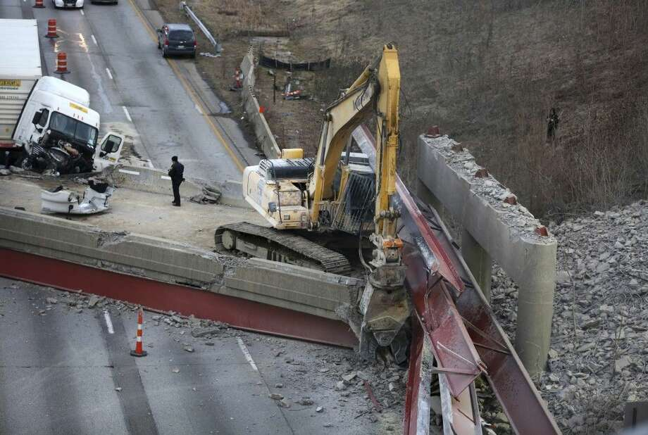 Work continues in the aftermath of the bridge collapse on Interstate 75 on Tuesday in Cincinnati.