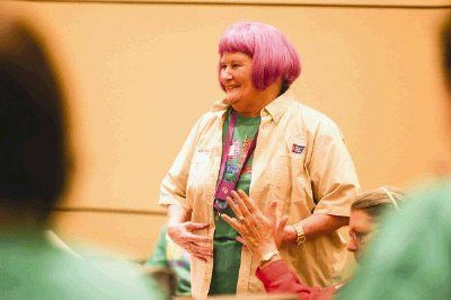 Diana Kammer, publicity chair for Relay for Life of Conroe, stands up for introductions during a kickoff Meeting Tuesday at the Greater Conroe/Lake Conroe Area Chamber of Commerce. To view this photo and others like it, visit HCNPics.com. Photo: Michael Minasi
