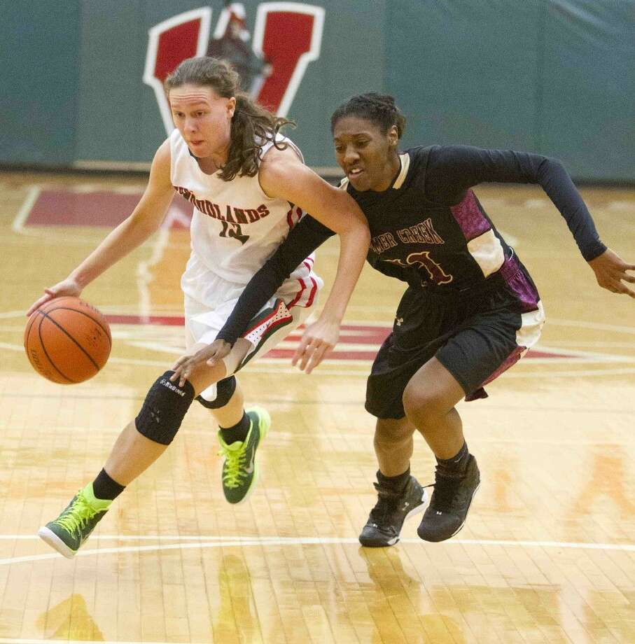 The Woodlands' Amber Terry drives toward the basket during a high school basketball game recently. Photo: Jason Fochtman