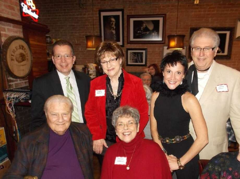 Betty Wolf, top center, is pictured at a birthday party thrown for her at the Red Brick Tavern by her husband, Gene, top right. Also pictured attending are bottom row, John Wiesner and Cecile Hanus. Top row from left are, Terry Hatfield, Betty Wolf, Amy Hatfield and Gene Wolf.