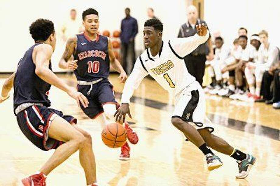 Conroe's Jay Lewis drives against Atascocita's Jerris Harris earlier this season. The Tigers are on the road tonight against the second-ranked Eagles. Photo: Michael Minasi