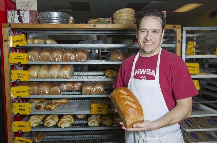 Manger Roberto Biassi poses for a photo at Great Harvest Bread Co. in The Woodlands. Great Harvest produces a variety of breads with fresh-milled wheat.