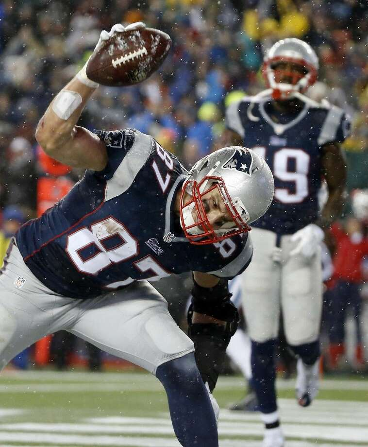 New England Patriots tight end Rob Gronkowski spikes the ball after catching a five-yard touchdown pass during the second half of the AFC championship game against the Indianapolis Colts on Sunday. Photo: Elise Amendola