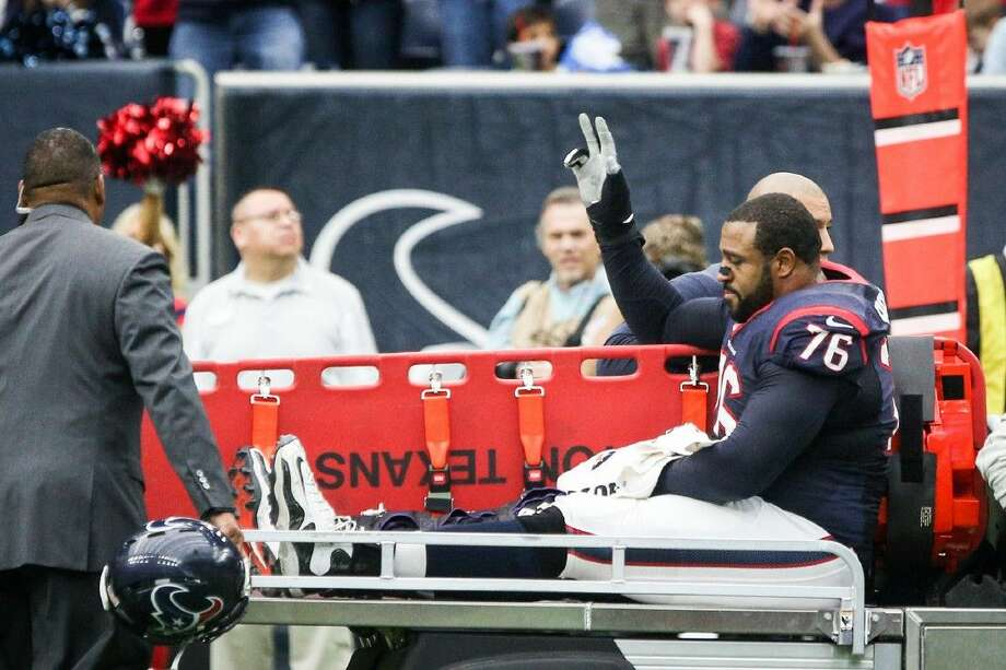 Tackle Duane Brown, of the Houston Texans, waves at the crowd after sustaining an injury during the NFL football game against the Jacksonville Jaguars on Sunday, Jan. 3, 2016, at NRG Stadium. To view more photos from the game, go to HCNPics.com. Photo: Michael Minasi
