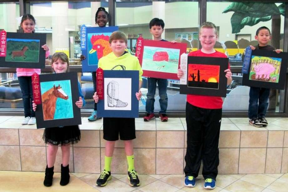 Buckalew students pose for a picture with their rodeo artwork