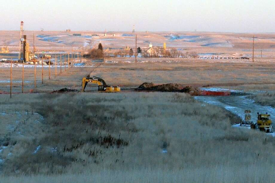 Crews dig up land Jan. 12 at a saltwater spill site near Blacktail Creek outside Williston, N.D.