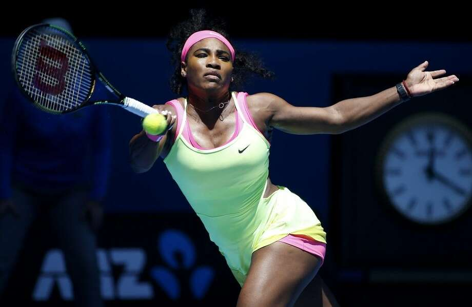 Serena Williams of the U.S. makes a forehand return during her second round match against Vera Zvonareva of Russia at the Australian Open tennis championship in Melbourne, Australia, on Thursday. Photo: Vincent Thian