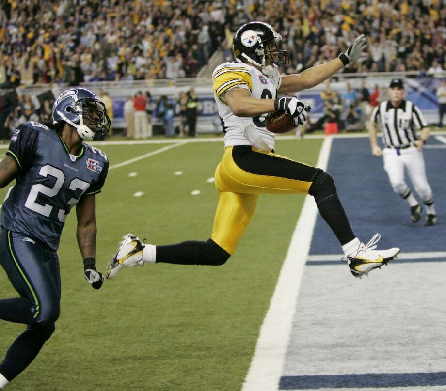 Pittsburgh Steelers wide receiver Hines Ward leaps into the end zone after catching a pass from wide receiver Antwaan Randle El during Super Bowl XL in 2006. Photo: DAVID J. PHILLIP