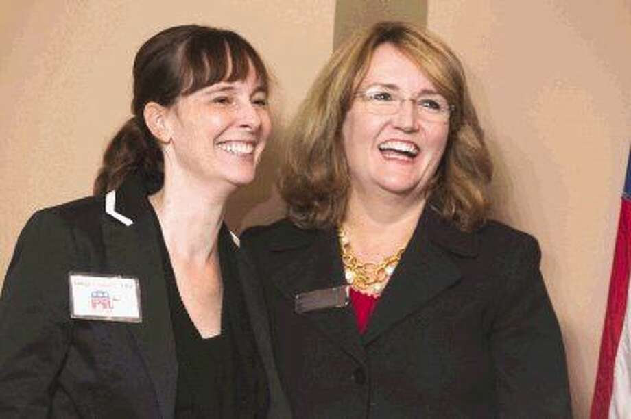 Judges Claudia Laird, of County Court-at-Law 2, and Lisa Michalk, of the 221st state District Court, laugh before speaking at the Montgomery County Republican Women's meeting Thursday at River Plantation County Club.