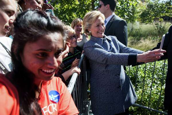 Hillary Clinton takes photos with attendees during a campaign event in Des Moines, Iowa, Sept. 29, 2016. (Doug Mills/The New York Times) ORG XMIT: XNYT144