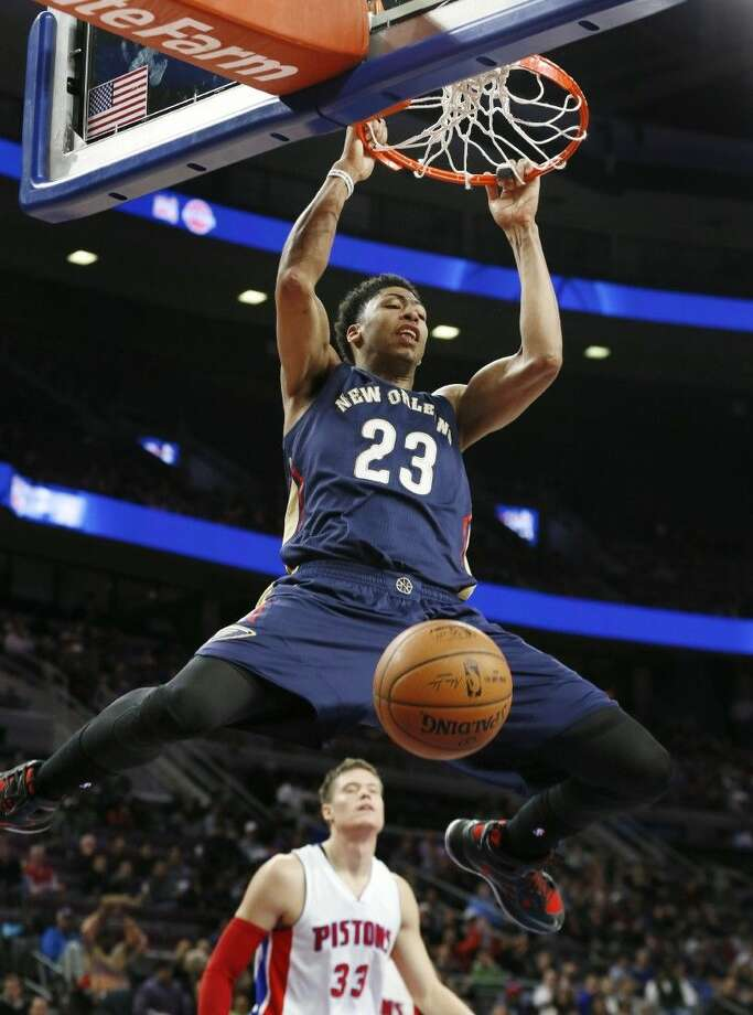 New Orleans Pelicans forward Anthony Davis dunks against the Detroit Pistons during the second half of a recent NBA basketball game. Photo: Paul Sancya