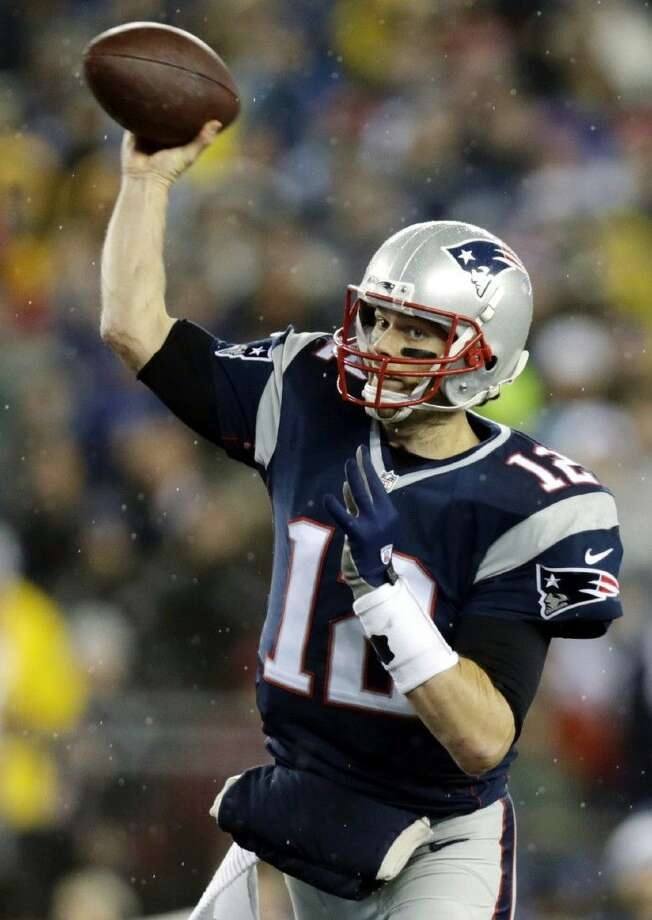 New England Patriots quarterback Tom Brady throws during the first half of the AFC championship NFL football game against the Indianapolis Colts. Photo: Charles Krupa