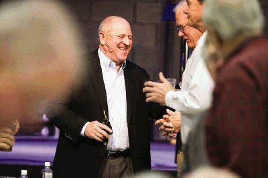 Mark McCollum, Chief Integration Officer at Halliburton, shakes hands with audience members after speaking during the Men's Power Lunch Series on Monday, Jan. 4, 2016, at First Baptist Church of Conroe. Photo: Michael Minasi