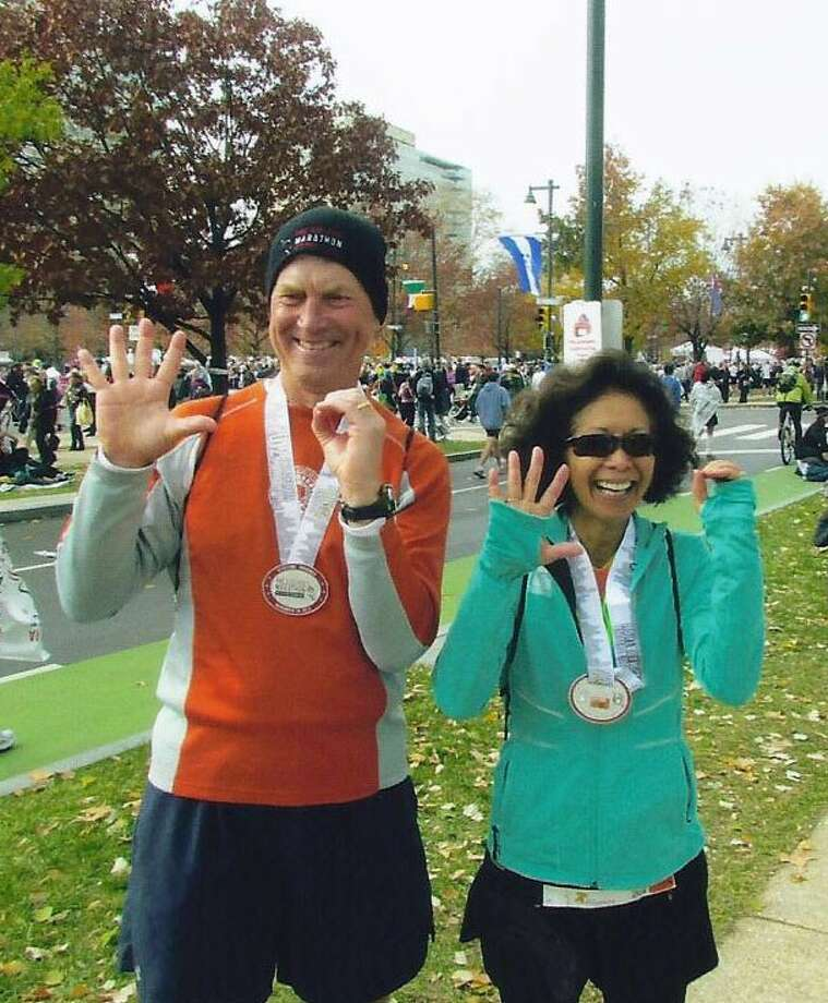 Tony Allison (left) and Geri Henry (right) recently joined the 50 States Marathon Club by completing the Philadelphia Marathon Nov. 18.