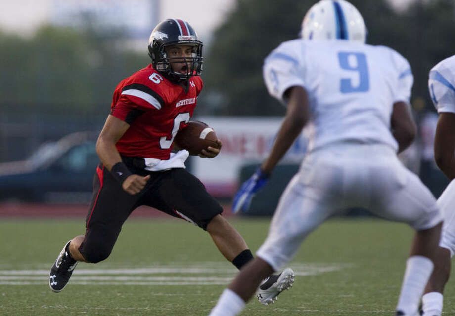 Westfield's William Dedon (6) scrambles for a first down against Aldine in the first half at Leonard George Stadium on Friday, Aug. 30, 2013, in Spring.