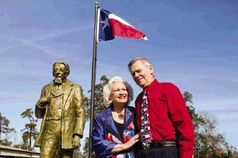 The great-great-great granddaughter of Charles B. Stewart, Pat Spackey and her husband, Tedd, stand before the newly unveiled bronze statue of Stewart during the 175th birthday of the Lone Star flag celebration at Cedar Brake Park in Montgomery Saturday. To view or purchase this photo and others like it, visit HCNpics.com. Photo: Staff Photo By Ana Ramirez / The Conroe Courier