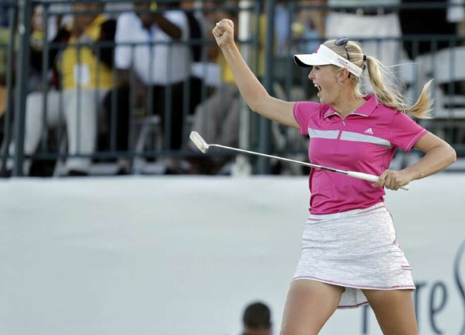 Jessica Korda of the U.S. celebrates on the 18th green after winning the LPGA Pure Silk Bahamas Classic. Stacy Lewis of The Woodlands finished second. Photo: Tim Aylen