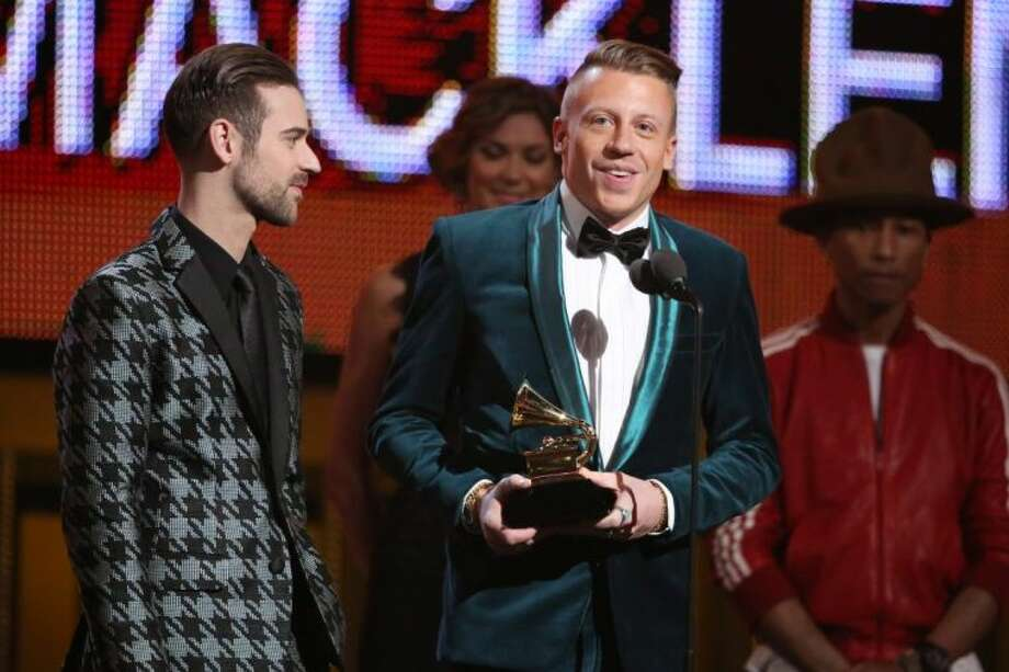 Ryan Lewis, left, and Macklemore accept the award for best new artist at the 56th annual Grammy Awards at Staples Center on Sunday. Photo: Matt Sayles