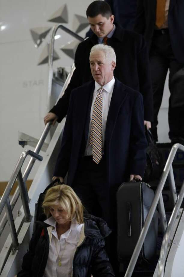 Broncos coach John Fox leaves the team plane in Newark, N.J. Photo: Matt Slocum