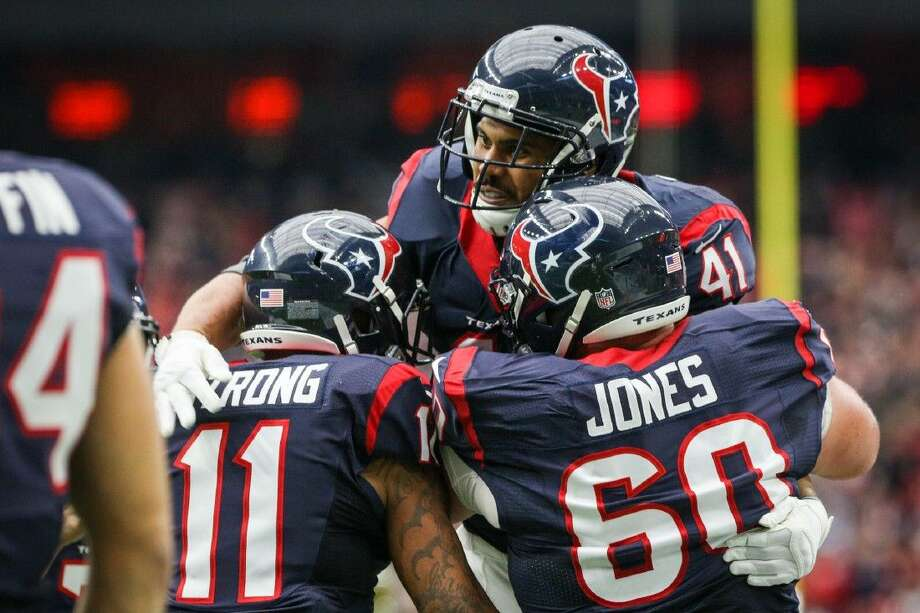 Running back Jonathan Grimes, of the Houston Texans, celebrates with teammates after scoring a touchdown during the first half of the NFL football game against the Jacksonville Jaguars on Sunday, Jan. 3, 2016, at NRG Stadium. To view more photos from the game, go to HCNPics.com. Photo: Michael Minasi
