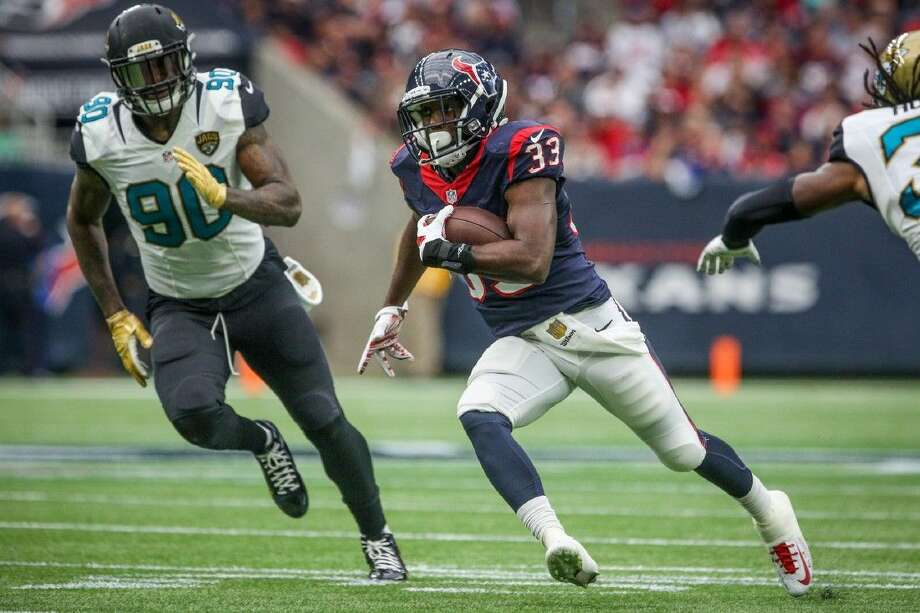 Running back Akeem Hunt, of the Houston Texans, runs the ball during the NFL football game against the Jacksonville Jaguars on Sunday, Jan. 3, 2016, at NRG Stadium. To view more photos from the game, go to HCNPics.com. Photo: Michael Minasi
