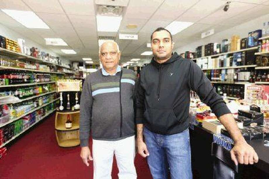 Father and son team Chintan Patel, right, and Vipinbhai Patel, left, own and manage Dylan's Liquor on Research Forest Drive in Alden Bridge. Photo: Michael Minasi