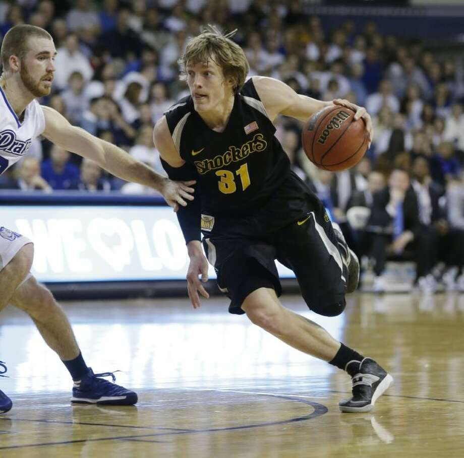 Wichita State guard Ron Baker, right, and the Shockers are unbeaten in 21 games. They reached the Final Four last season. Photo: Charlie Neibergall