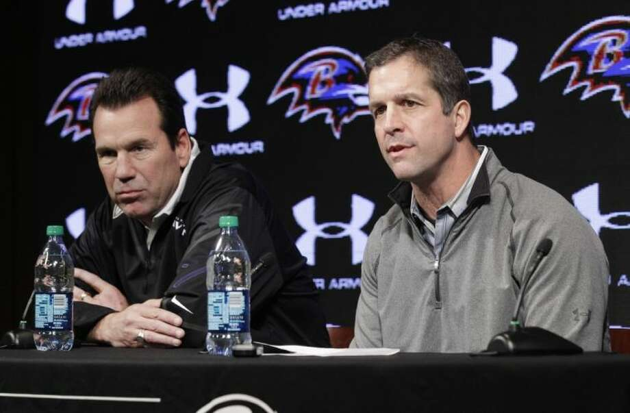 Ravens offensive coordinator Gary Kubiak, left, listens as head coach John Harbaugh talks to the media. Kubiak was the Texans' head coach for six seasons.