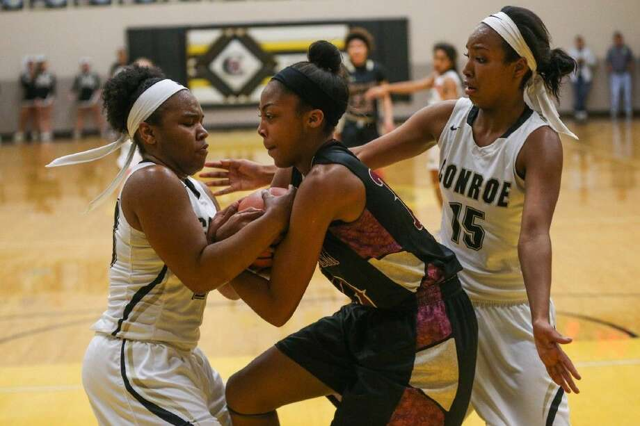 Conroe's Erica Powell (23) struggles with Summer Creek's Aiyana Bean (10) as Victoria Ratcliff (15) guards during the high school girls basketball game on Friday, Jan. 8 2016, at Conroe High School. To view more photos from the game, go to HCNPics.com. Photo: Michael Minasi