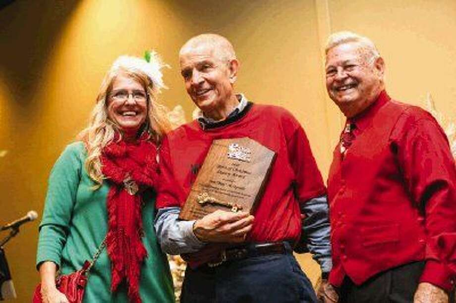 "Jim ""Mattress Mack"" McIngvale receives the Sprit of Christmas Legacy Award from the Lone Star Santas organization while flanked by Terri Jaggers, President of the Montgomery County CPS, and last year's award recipient, Tony Gullo, of Gullo Dealerships, on Saturday at La Torretta Lake Resort & Spa. Photo: Michael Minasi"