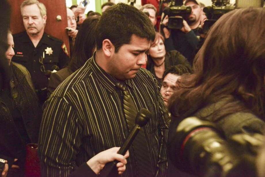 In this Friday photo, Erick Munoz, husband of Marlise Munoz, is escorted out of court by his attorney Heather L. King, right, in Fort Worth. Photo: TIM SHARP