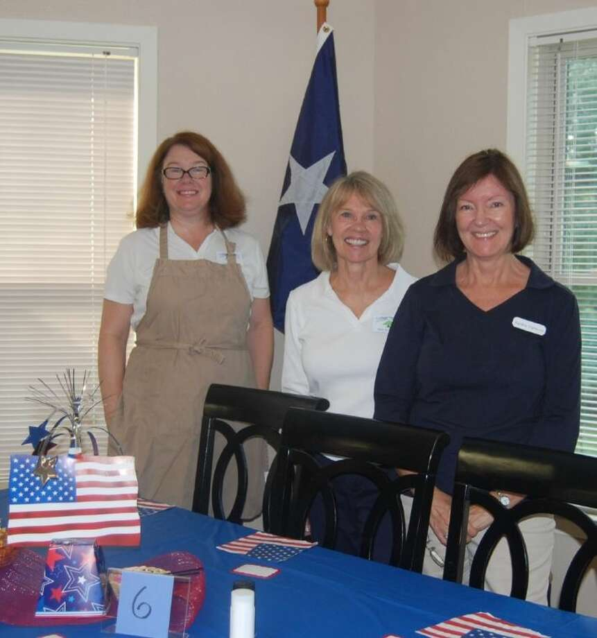 Members of the Cypress-Woodlands Junior Forum are all smiles at a recent event. The group hosted a luncheon for seniors at Harvestwood Apartments in The Woodlands.