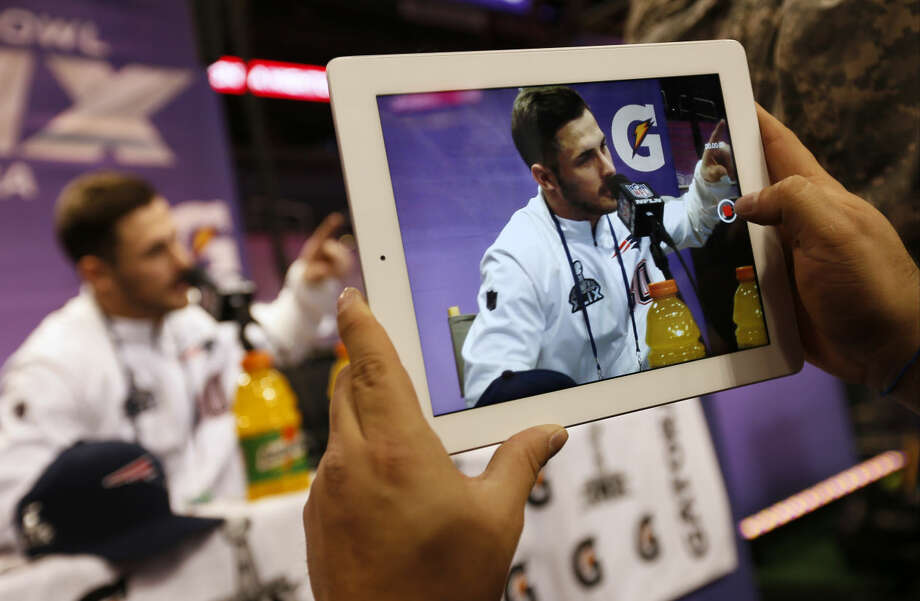 A reporter takes an iPad photo of New England Patriots' Danny Amendola as he answers questions during media day for NFL Super Bowl XLIX football game Tuesday, Jan. 27, 2015, in Phoenix. (AP Photo/Matt York) Photo: Matt York