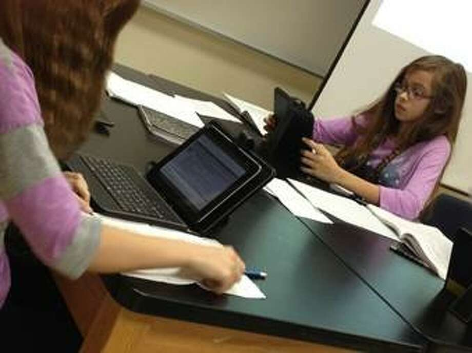 Science students at Brabham Middle School learn on their new Android tablets.