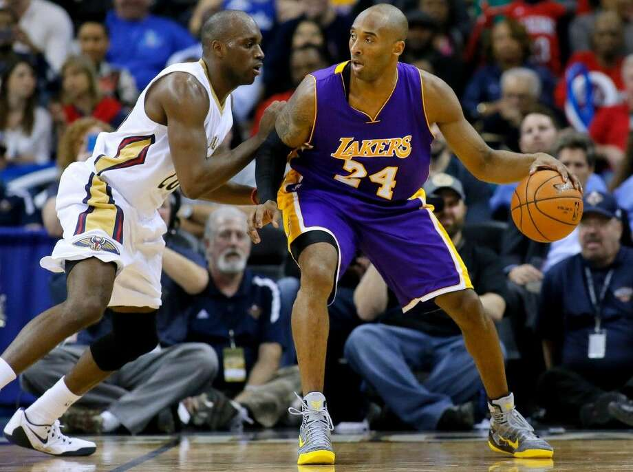 Los Angeles Lakers guard Kobe Bryant drives against New Orleans Pelicans guard Quincy Pondexter during the second half of an NBA basketball game earlier this season in New Orleans. Photo: Jonathan Bachman
