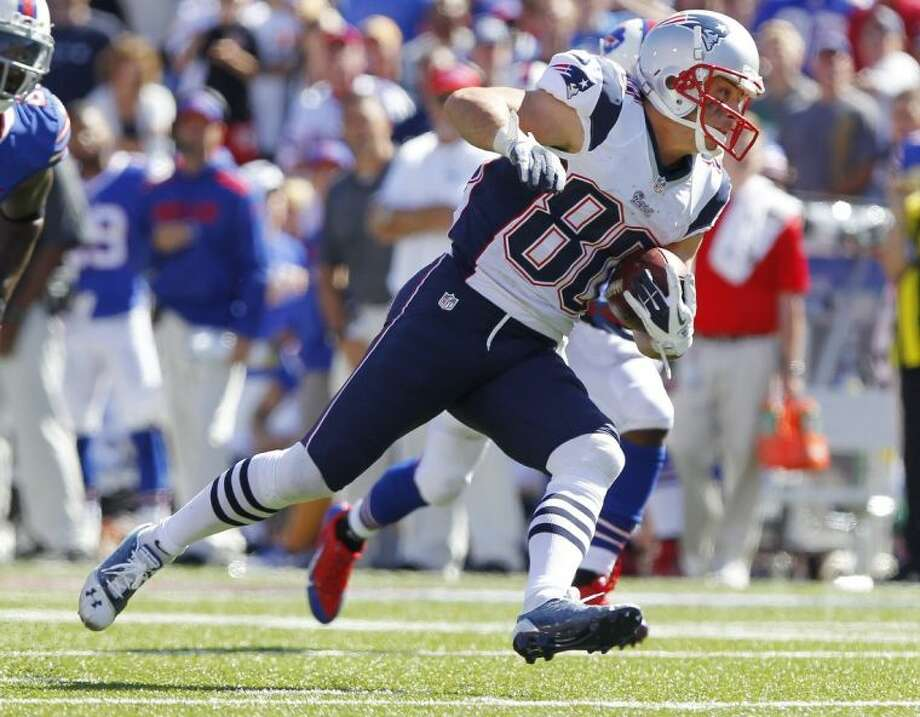 Patriots wide receiver Danny Amendola looks for yardage against the Bills. Amendola, who played high school football at The Woodlands, had 10 catches for 104 yards in the Patriots' 23-21 victory.