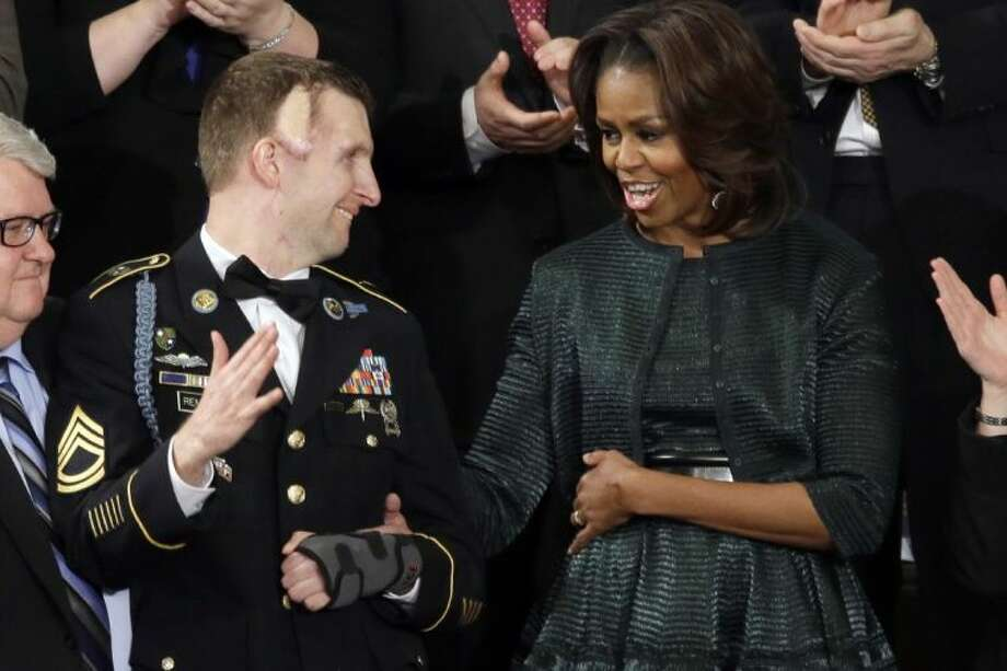 First lady Michelle Obama talks with Army Ranger Sgt. 1st Class Cory Remsburg during President Barack Obama's State of the Union address on Capitol Hill in Washington Tuesday. Photo: J. Scott Applewhite