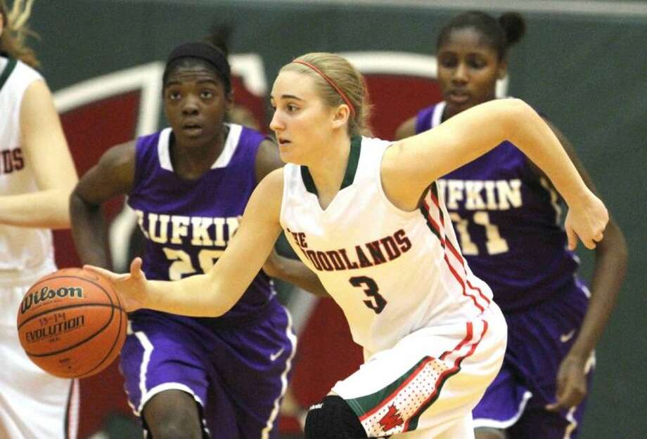 The Woodlands guard Katie Burke starts a fast break during a District 14-5A girls basketball game against Lufkin Wednesday. The Woodlands defeated Lufkin 60-44. To view or purchase this photo and others like it, visit HCNpics.com. Photo: Jason Fochtman