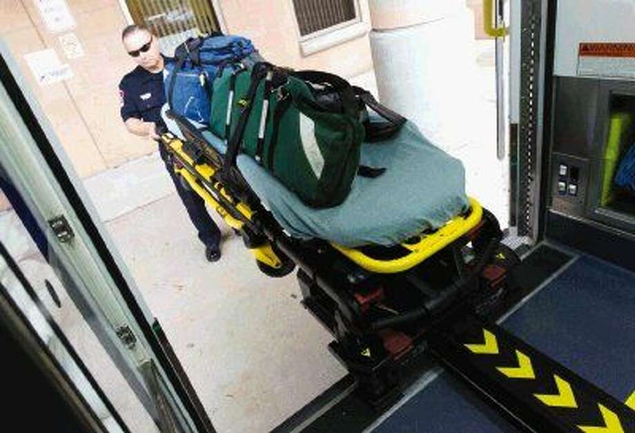 One of the main reasons the Montgomery County Hospital District is outfitting its ambulances with self-loading stretchers is to improve the health of EMS workers, who have to lift patient, gear and stretcher several times in their 24-hour shift. In addition to both hydraulic and manual controls, the stretcher also has a guide track to better stabilize patients once in the vehicle. Photo: Jason Fochtman
