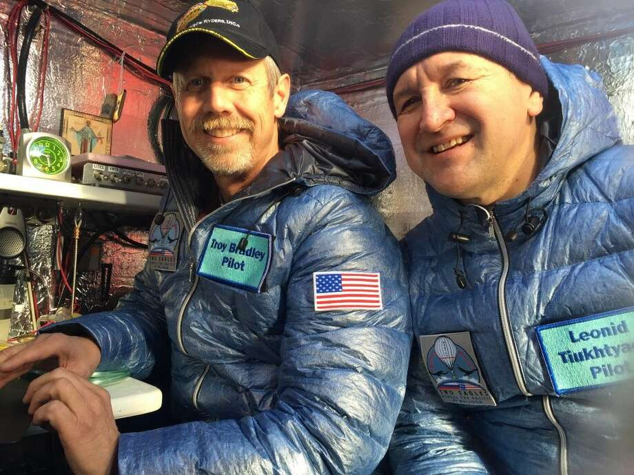 Troy Bradley, left, and Leonid Tiukhtyaev before they lift off in a gas balloon Jan. 8 in Saga, Japan. The Two Eagles pilots have traveled farther and longer in a gas balloon than anyone in history in a bid to remove the qualifiers that have complicated a century of record keeping in long-distance ballooning. Now they're aiming for a safe landing on the beaches of Baja California. Photo: HONS