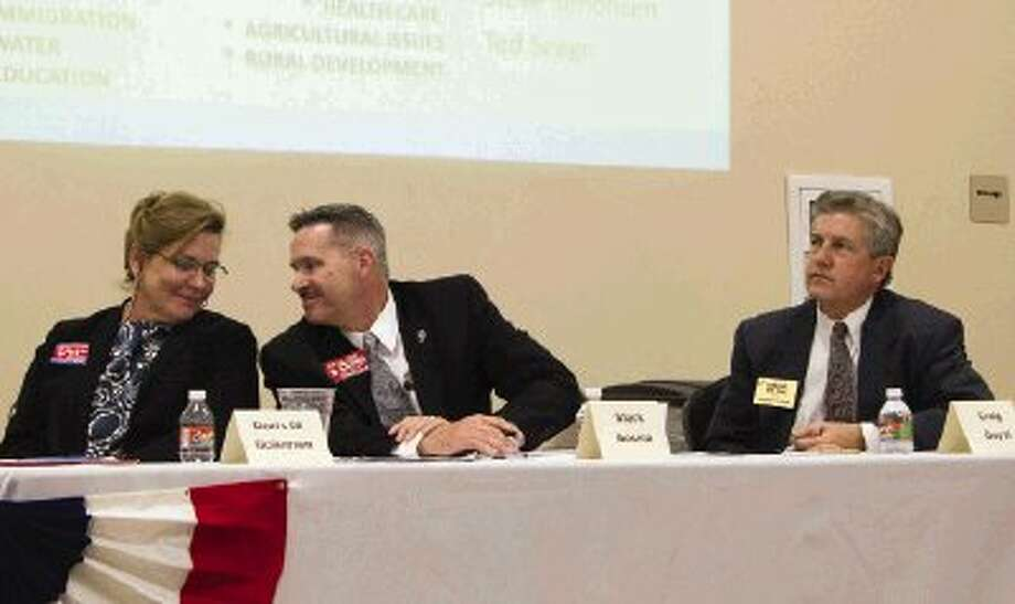 Montgomery County Judge candidates Doris Golemon, Mark Bosma and Craig Doyal wait to speak during a candidate forum Thursday night. Candidates running for District 16 state representative and Precinct 1 justice of the peace also spoke during the event hosted by the North Shore Republican Women at the North Montgomery County Community Center in Willis. / The Conroe Courier