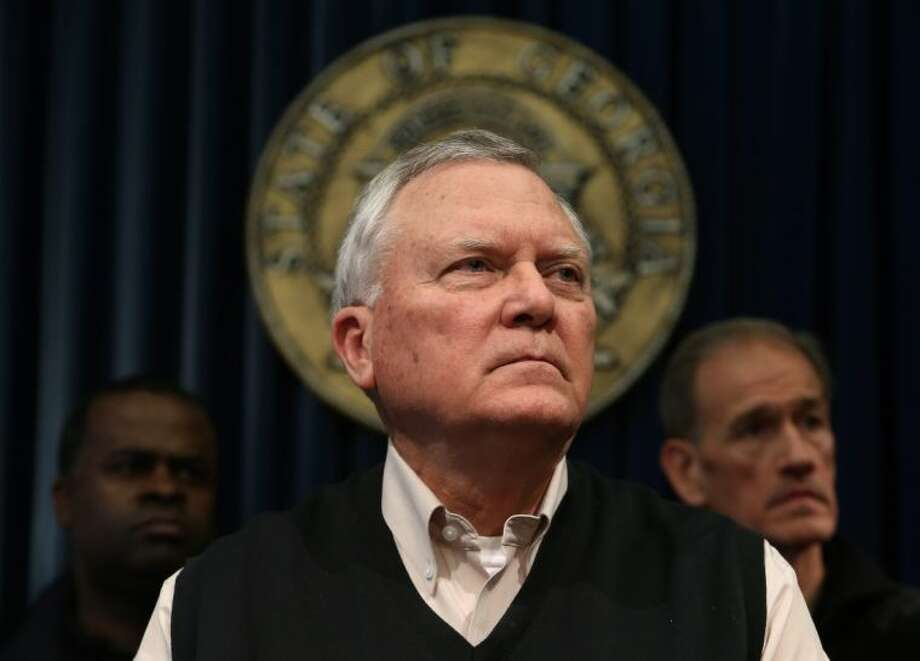 Gov. Nathan Deal listens to a question about the state's response to the snow storm during a news conference Wednesday in Atlanta. A rare snowstorm left thousands across the South frozen in their tracks, with workers sleeping in their offices, students camping in their schools, and commuters abandoning cars along the highway to seek shelter in churches or even grocery stores. Photo: BEN GRAY / AJC