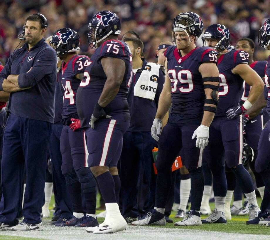 Defensive end J.J. Watt, of the Houston Texans, is seen on the sideline during the third quarter of an NFL wild card playoff football game Saturday, Jan. 9, 2016, in Houston. Photo: Jason Fochtman