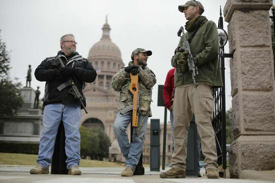 Gun rights advocates carry rifles while protesting outside the Texas Capitol on Jan. 13 in Austin. Photo: Eric Gay
