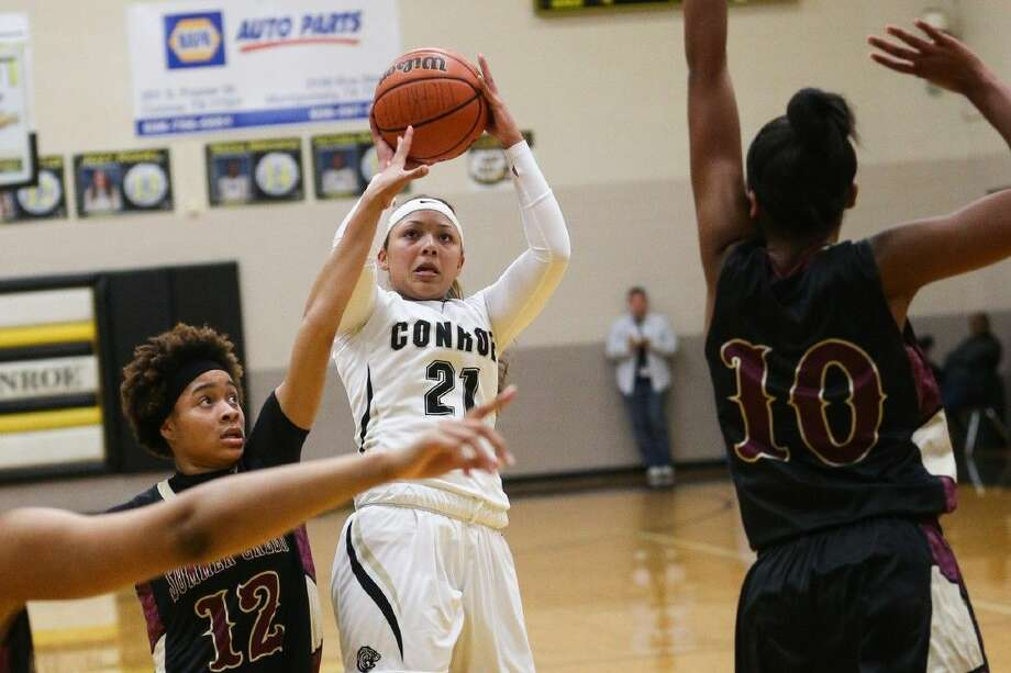Conroe senior Jordan Allen (21), shown here this past Friday night shooting against Summer Creek, is averaging at team-high 12.5 points per game. Photo: Michael Minasi