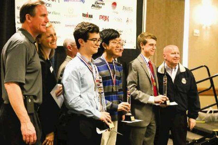 Grand Award winners, from left, Matthew Webb, Andrew Kim and Nicholas Bracci pose for a photograph during the Education for Tomorrow Alliance's 25th annual SCI://TECH Expo on Saturday at the Lone Star Convention and Expo Center. To view or purchase this photo and others like it, visit HCNpics.com.
