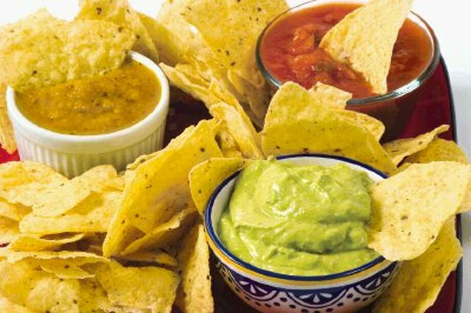 Go for baked chips, healthier guacamole, salsa and hummus for better-for-you Super Bowl snacks. Photo: Unknown