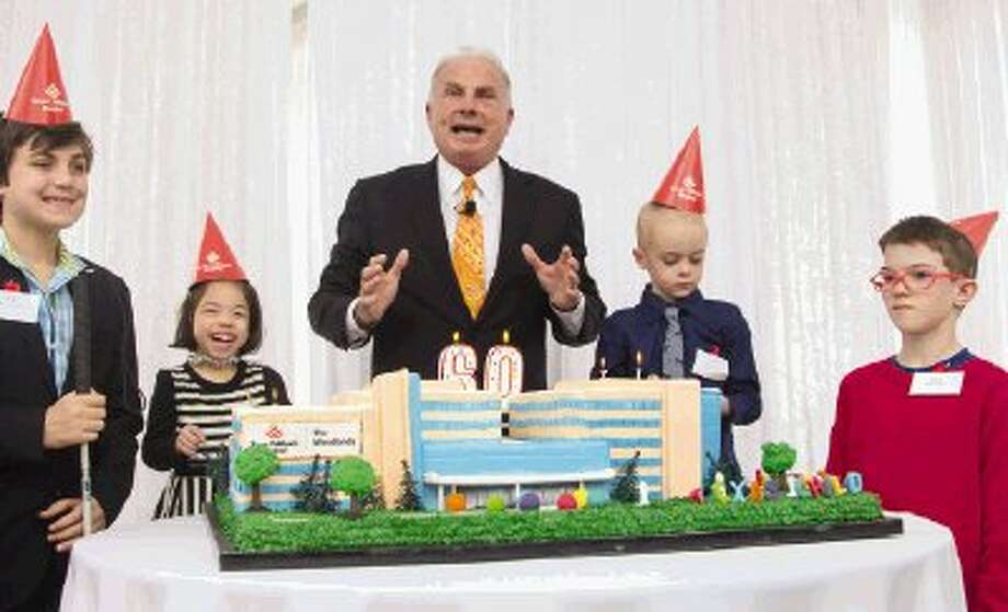 Former patients of Texas Children's Hospital join CEO Mark A. Wallace to blow out candles during the hospital's 60th birthday celebration Friday in The Woodlands. A groundbreaking ceremony for the newest hospital, expected to open by 2017 in The Woodlands, also was held during the event. To view or purchase this photo and others like it, visit HCNpics.com. / The Conroe Courier/ The Woodland